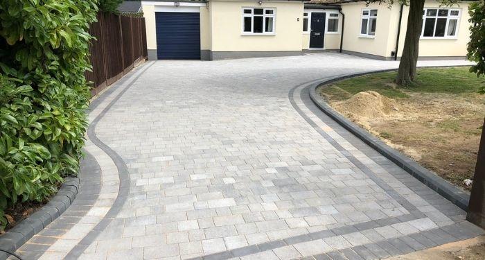 large grey block paving driveway