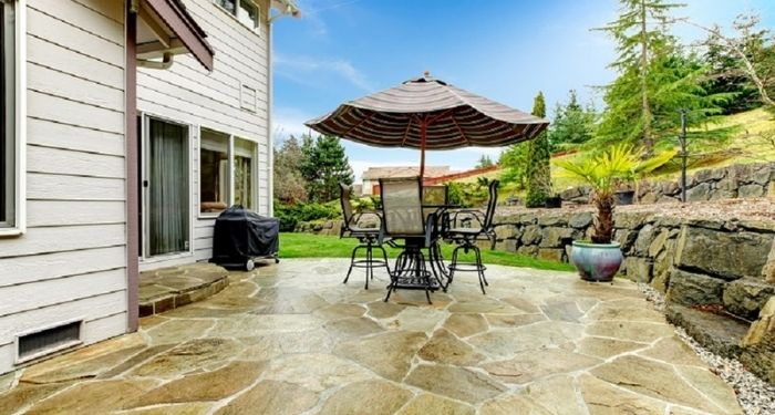 stone pavings slabs and table and chairs