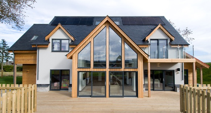 big house with large windows and decking