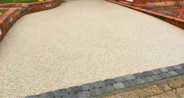 Beige resin bonded driveway