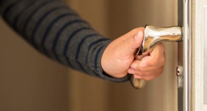 man using a door handle