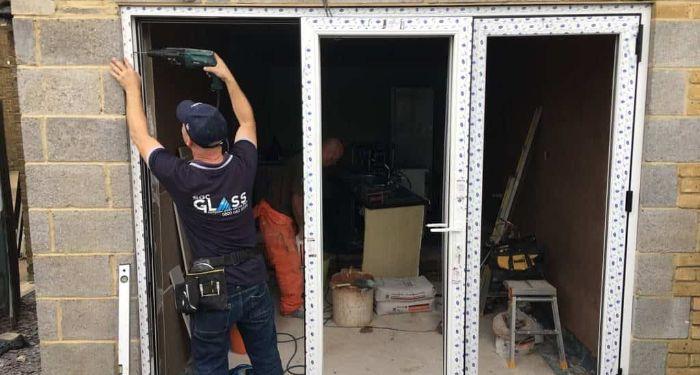 man inserting bifold frame