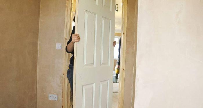 woman hanging a white door
