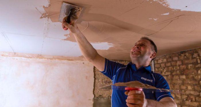 plasterer plastering a ceiling