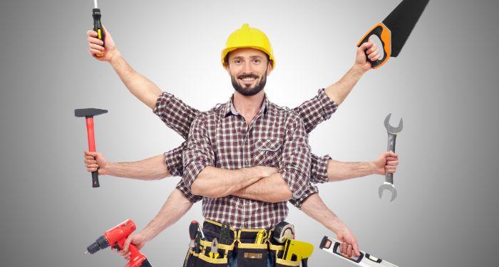 man holding multiple tools